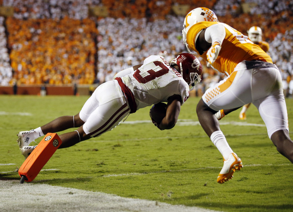 Photo - Oklahoma's Sterling Shepard (3) scores a touchdown in double overtime in front of Tennessee's Emmanuel Moseley (12) during the college football game between the Oklahoma Sooners (OU) and the Tennessee Volunteers at Neyland Stadium in Knoxville, Tennessee, Saturday, Sept. 12, 2015. OU won 31-24 in double overtime. Photo by Nate Billings, The Oklahoman