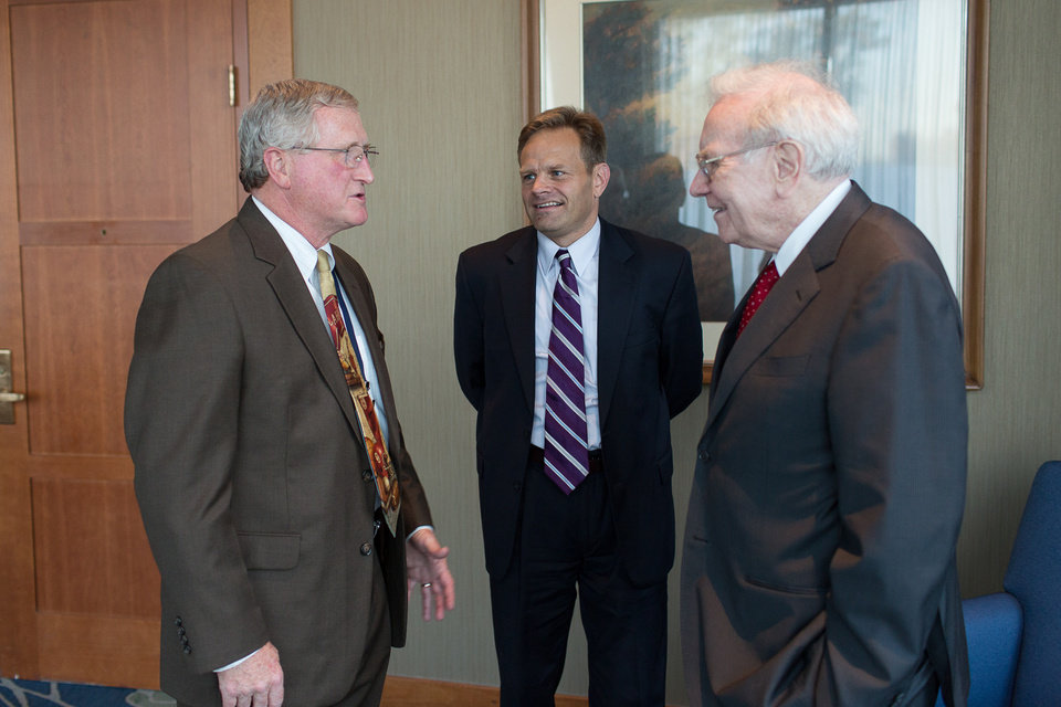 Photo - PLICO CEO Dr. Carl T Hook visits with President and CEO of MedPro Tim Kenesey and Berkshire Hathaway Chairman Warren Buffett. Photo provided by PLICO.
