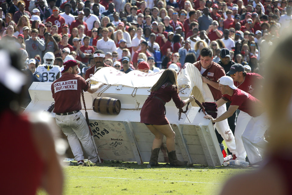 Photo - The Sooner Schooner is carried off the field during a college football game between the University of Oklahoma Sooners (OU) and the West Virginia Mountaineers at Gaylord Family-Oklahoma Memorial Stadium in Norman, Okla, Saturday, Oct. 19, 2019. [Bryan Terry/The Oklahoman]