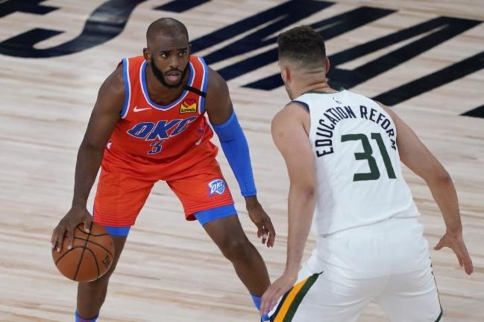 Photo -  Thunder guard Chris Paul (3) tries to work around the defense of Jazz forward Georges Niang (31) during OKC's 110-94 win Saturday in Lake Buena Vista, Fla. [Ashley Landis/Pool Photo via USA TODAY Sports]