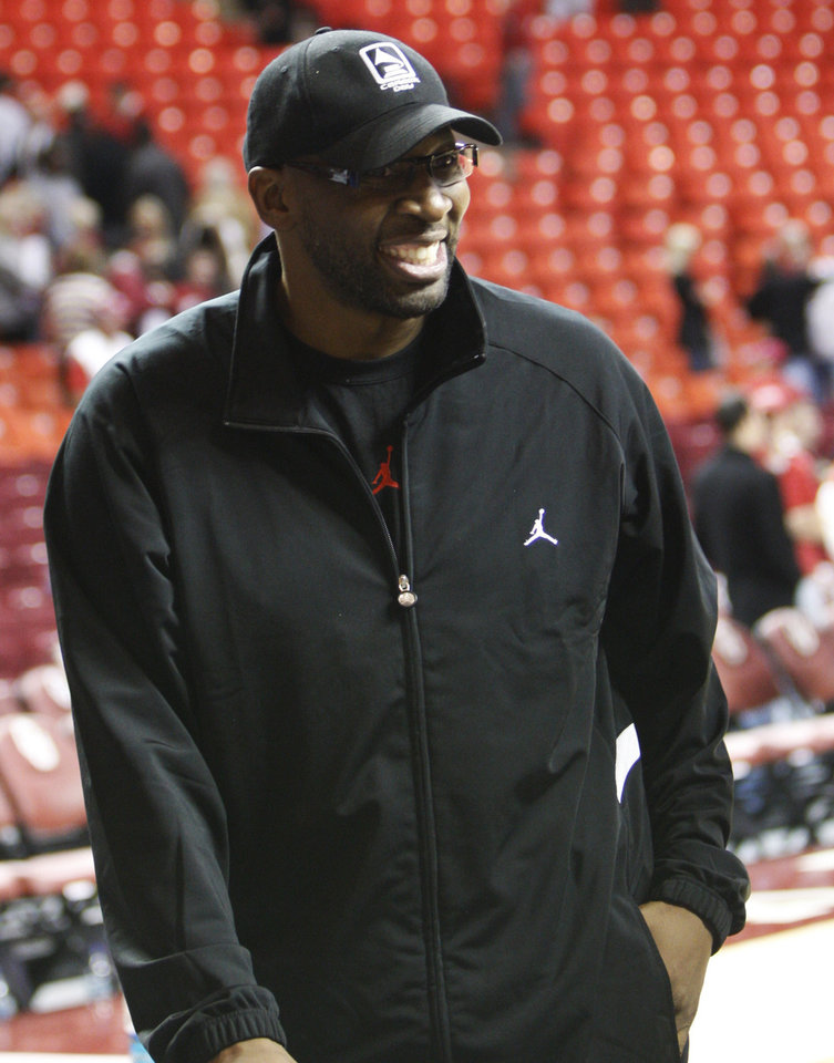 Photo - Wayman Tisdale, University of Oklahoma's all-time leading scorer, smiles as he leaves an NCAA college basketball game between OU and Southern California in Norman, Okla., Thursday, Dec. 4, 2008. (AP Photo/Sue Ogrocki) ORG XMIT: OKSO110