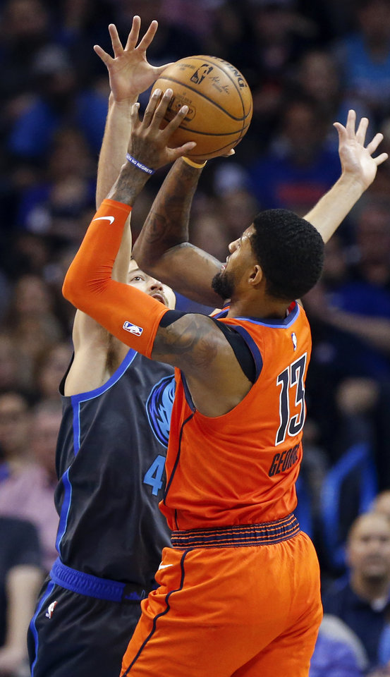 Photo - Oklahoma City's Paul George (13) shoots against Dallas' Ryan Broekhoff (45) in the fourth quarter during an NBA basketball game between the Dallas Mavericks and the Oklahoma City Thunder at Chesapeake Energy Arena in Oklahoma City, Sunday, March 31, 2019. Dallas won 106-103. Photo by Nate Billings, The Oklahoman