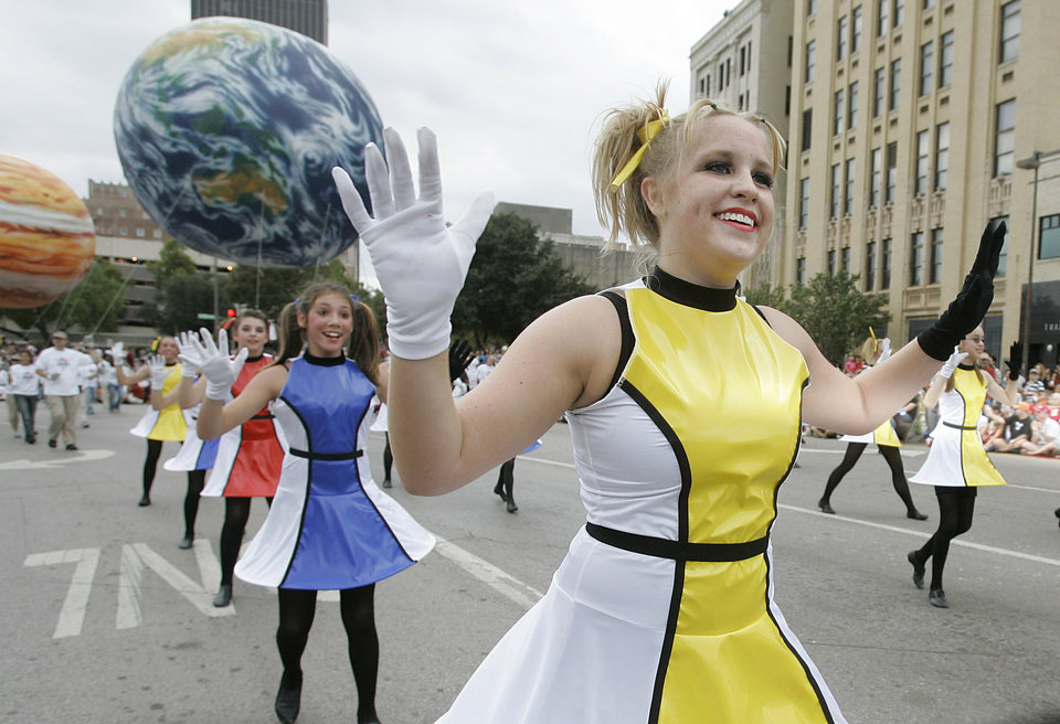 Photo - Leah Kostelecky of Oklahoma city does a space dance along E.K. Gaylord blvd.  in the Oklahoma Centennial Parade Saturday, Oct. 14, 2007 BY JACONNA AGUIRRE/THE OKLAHOMAN.