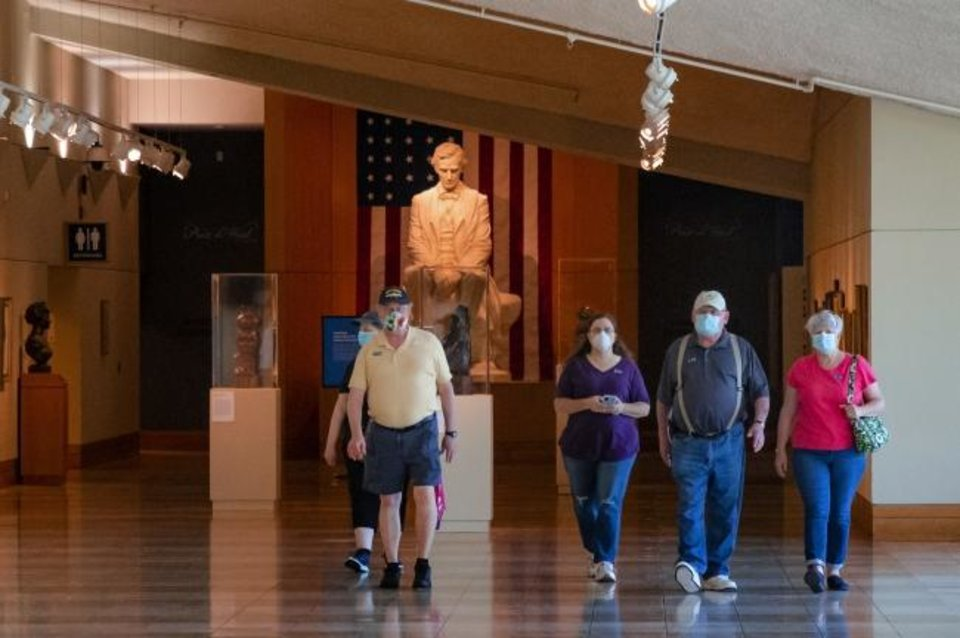 Photo -  Visitors walk down the hallway May 18 as they check out the sights in the National Cowboy & Western Heritage Museum. The museum reopened to the public after being closed two months due to the coronavirus pandemic.  [Chris Landsberger/The Oklahoman]