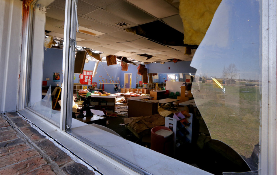 Photo - Damage  from Wednesday's tornadoes at the Kids USA day care facility on South Robinson is shown on Thursday, March 26, 2015 in Moore, Okla. Photo by Steve Sisney, The Oklahoman