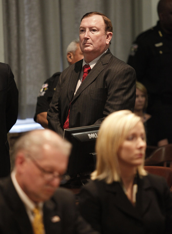 Photo - Jerome Ersland stands as his guilty verdict is read to the court as Oklahoma County District Attorney David Prater, left , and assistant  District Attorney Jennifer Chance are seated in Judge Ray C. Elliott's court in Oklahoma City, Oklahoma , Thursday, May 26, 2011. Photo by Steve Gooch, Pool/ The Oklahoman