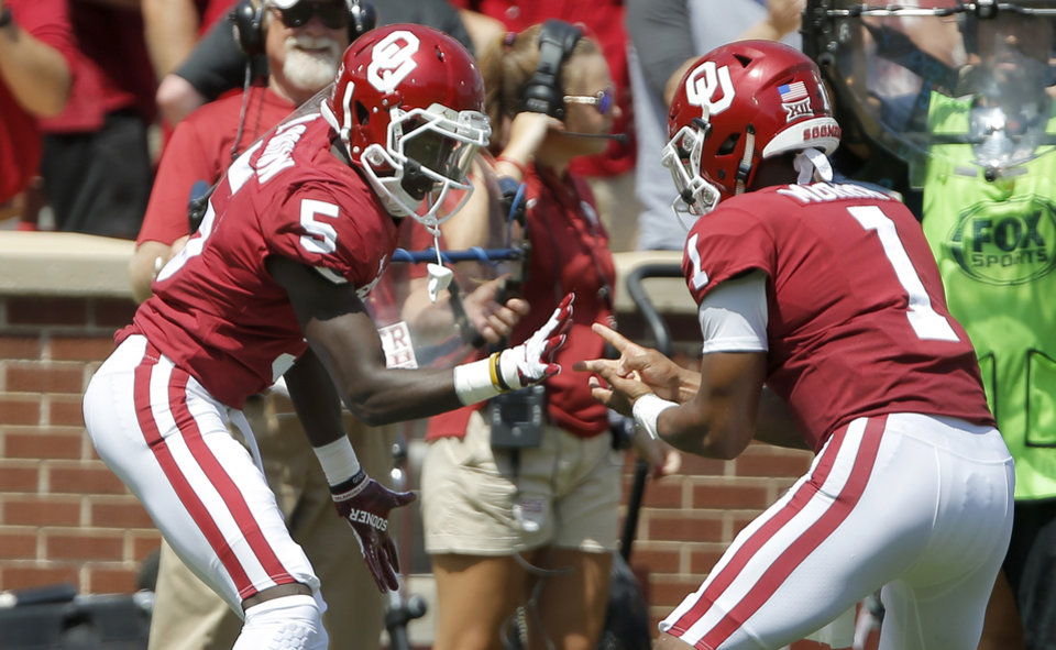 Photo -  Rock, paper, scissors, whatever Kyler Murray and Marquise Brown (5) did against Florida Atlantic worked. [Photo by Bryan Terry, The Oklahoman]