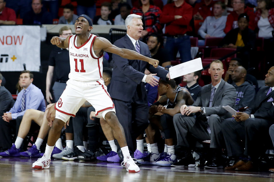 Photo - Oklahoma's De'Vion Harmon (11) celebrates in front of the Kansas State bench during an NCAA college basketball game between the University of Oklahoma Sooners (OU) and the Kansas State Wildcats at Lloyd Noble Center in Norman, Okla., Saturday, Jan. 4, 2020. Oklahoma won 66-61. [Bryan Terry/The Oklahoman]
