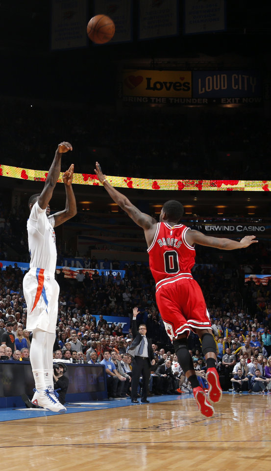 Photo - Oklahoma City's Anthony Morrow (2) shoots over Chicago's Aaron Brooks (0) during the NBA game between the Oklahoma City Thunder and the Chicago Bulls at Chesapeake Energy Arena in Oklahoma City, Sunday, March  15, 2015. Photo by Sarah Phipps, The Oklahoman