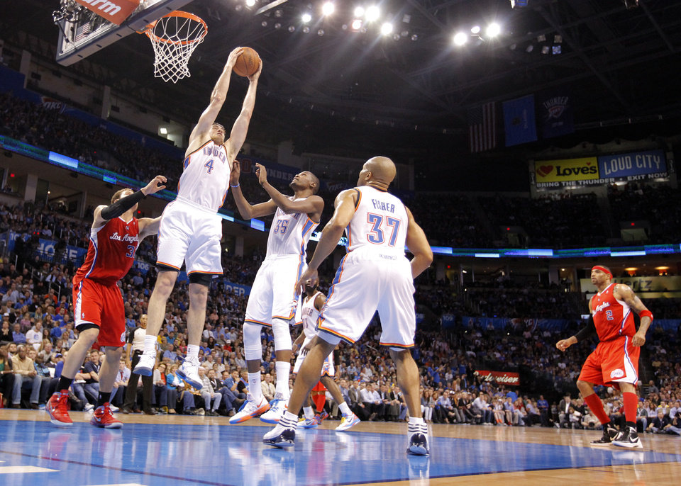 Photo - Oklahoma City Thunder power forward Nick Collison (4) pulls in the rebound over Los Angeles Clippers power forward Blake Griffin (32) as Oklahoma City Thunder small forward Kevin Durant (35) and Derek Fisher (37) look on during the NBA basketball game between the Oklahoma City Thunder and the Los Angeles Clippers at Chesapeake Energy Arena on Wednesday, March 21, 2012 in Oklahoma City, Okla.  Photo by Chris Landsberger, The Oklahoman