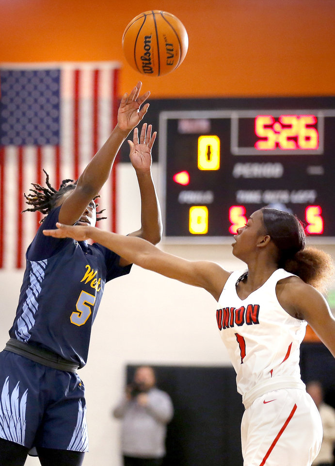 Photo - Putnam City West's Sharonica Hartsfield shoots as Union's Darian Carrr during the girls championship game between Putnam City West and Tulsa Union at the Putnam City Invitational at Putnam City High School in Oklahoma City, Okla.,  Saturday, Jan. 11, 2020.  [Sarah Phipps/The Oklahoman]