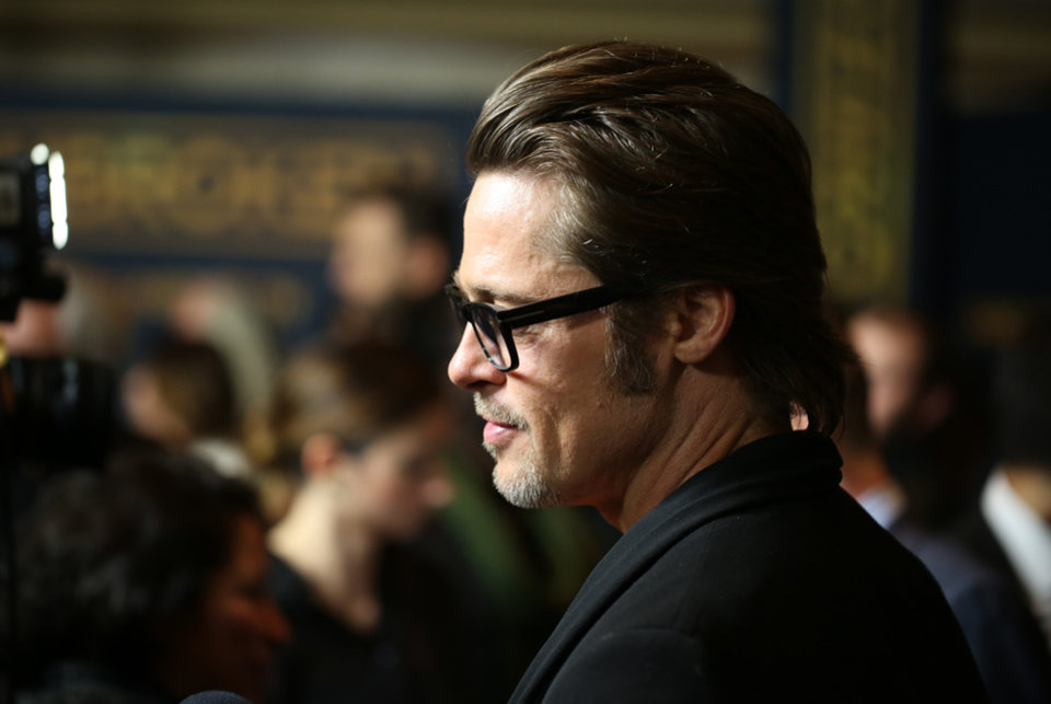 3f59defa521 Brad Pitt arrives at the Los Angeles premiere of  quot Unbroken quot  at  TCL Chinese