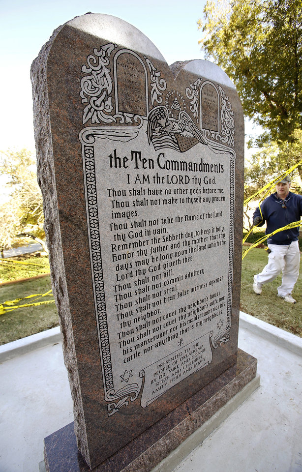 Photo - Seven-foot-tall granite monument of the Ten Commandments  is erected on the north side of the state Capitol grounds Thursday morning, Nov. 15, 2012.  Photo by Jim Beckel, The Oklahoman