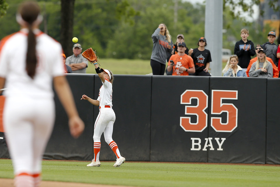 Photo - Oklahoma State's Chelsea Alexander (55) catches the ball for an out in the sixth inning of the Stillwater Regional NCAA softball tournament game between Oklahoma State University (OSU) and Tulsa in Stillwater, Okla., Saturday, May 18, 2019. Oklahoma State won 2-1. [Bryan Terry/The Oklahoman]