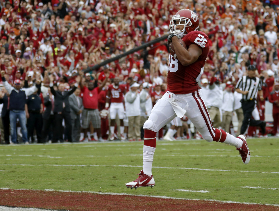 Photo - Oklahoma's Alex Ross (28) returns a kick for a touchdown during the Red River Showdown college football game between the University of Oklahoma Sooners (OU) and the University of Texas Longhorns (UT) at the Cotton Bowl in Dallas on Saturday, Oct. 11, 2014. 