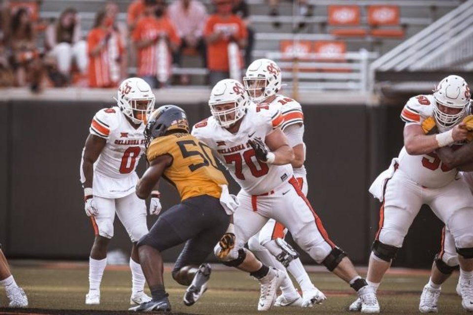 Photo -  Oklahoma State offensive lineman Hunter Woodard (70) will make his third career start against Iowa State on Saturday. [BRUCE WATERFIELD/COURTESY OF OSU ATHLETICS]