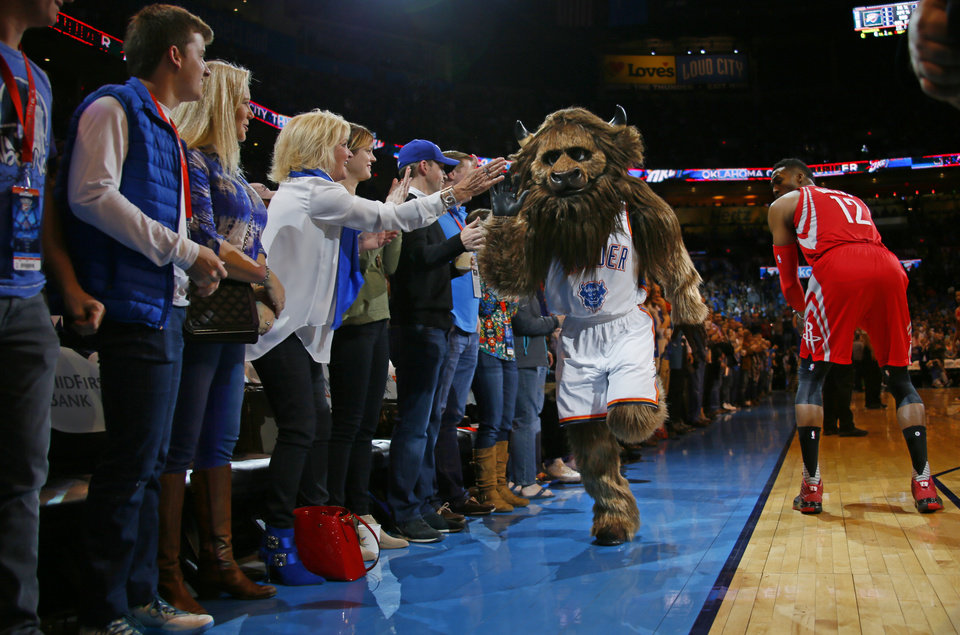 Photo - Rumble the Bison entertains fans during an NBA basketball game between the Oklahoma City Thunder and the Houston Rockets at Chesapeake Energy Arena in Oklahoma City, Friday, Jan. 29, 2016. Oklahoma City won 116-108. Photo by Bryan Terry, The Oklahoman