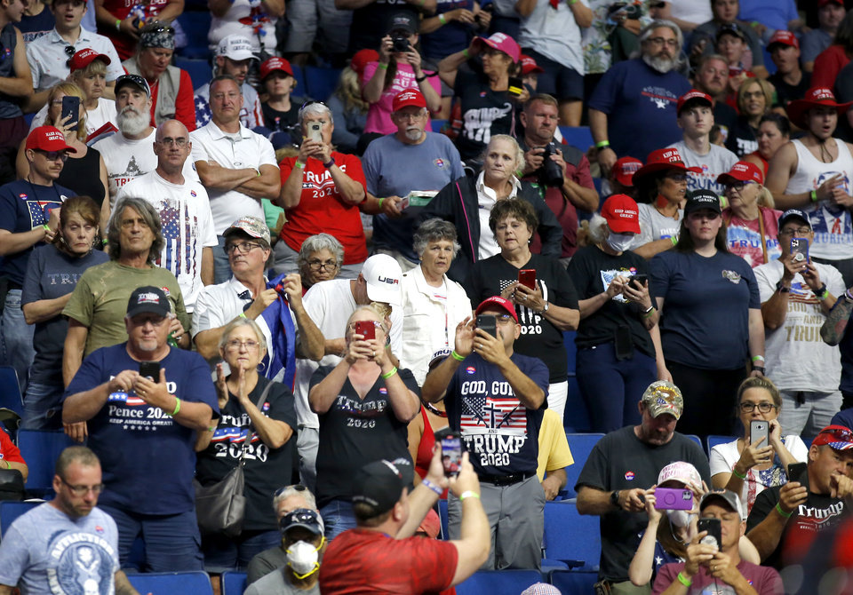 Photo - Supports cheer for Eric Trump before the President Donald Trump rally at the BOK in Tulsa, Okla., Saturday, June 20, 2020. [Sarah Phipps/The Oklahoman]