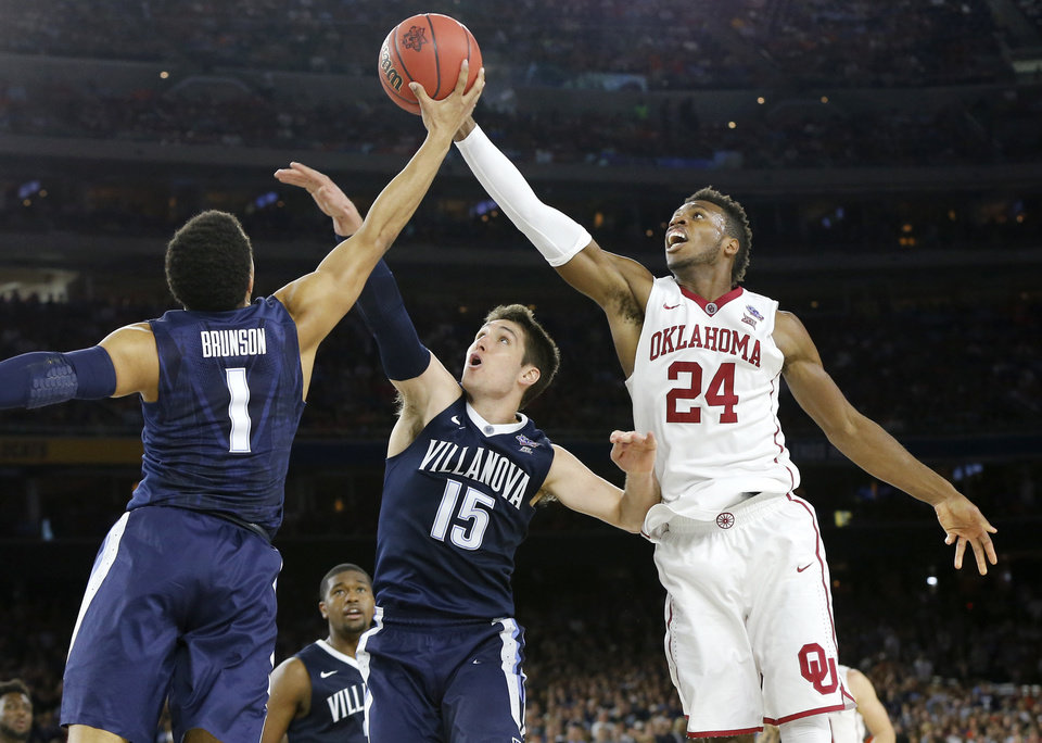 Photo - Oklahoma's Buddy Hield (24) reaches for the ball beside Villanova's Jalen Brunson (1) and Ryan Arcidiacono (15) during the national semifinal between the Oklahoma Sooners (OU) and the Villanova Wildcats in the Final Four of the NCAA Men's Basketball Championship at NRG Stadium in Houston, Saturday, April 2, 2016. Photo by Nate Billings, The Oklahoman