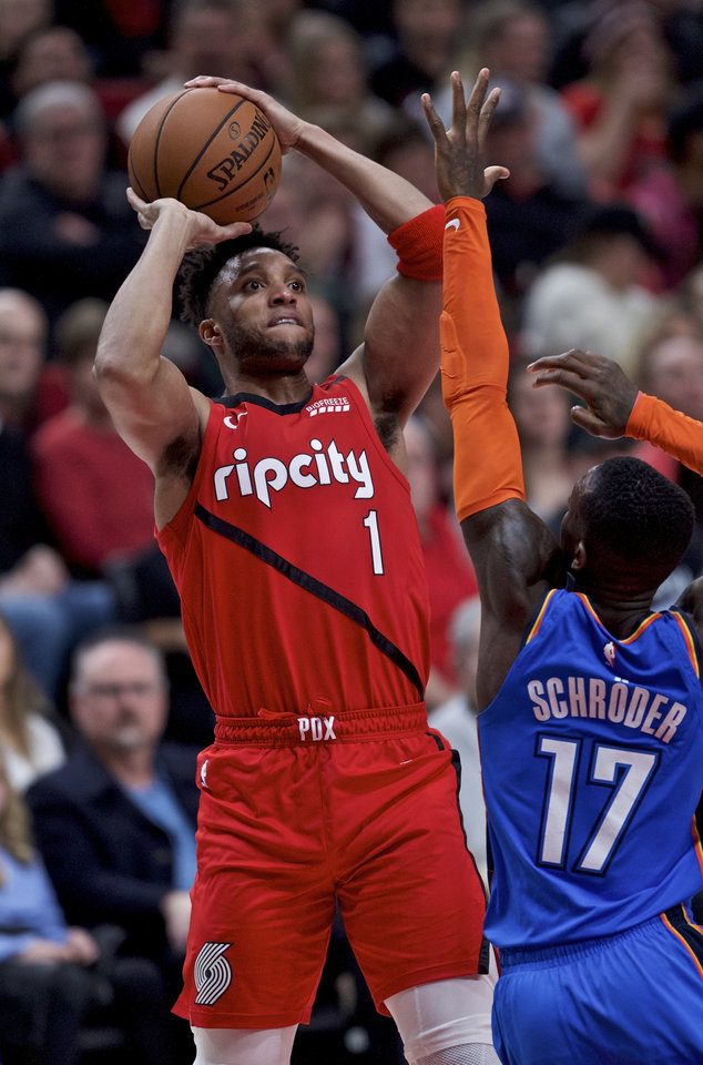 Photo - Portland Trail Blazers guard Evan Turner, left, shoots over Oklahoma City Thunder guard Dennis Schroeder during the second half of an NBA basketball game in Portland, Ore., Friday, Jan. 4, 2019. (AP Photo/Craig Mitchelldyer)