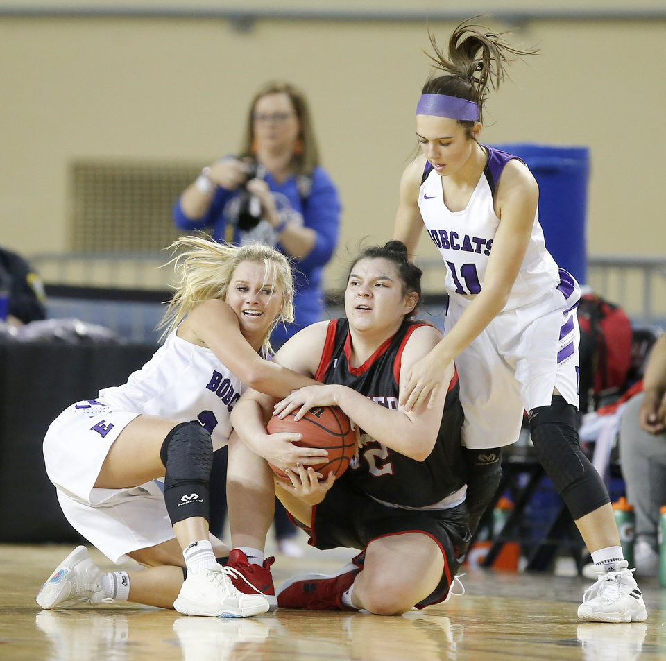 Photo - Hydro-Eakly's Gabbi Parker, left, and Raegan Klaassen fight with Frontier's Autumn Conneywerdy for the ball during a Class A girls semifinal game between Hydro-Eakly and Frontier during the state high school basketball tournament inside Jim Norick Arena at State Fair Park in Oklahoma City Okla., Friday, March 1, 2019. Photo by Bryan Terry, The Oklahoman