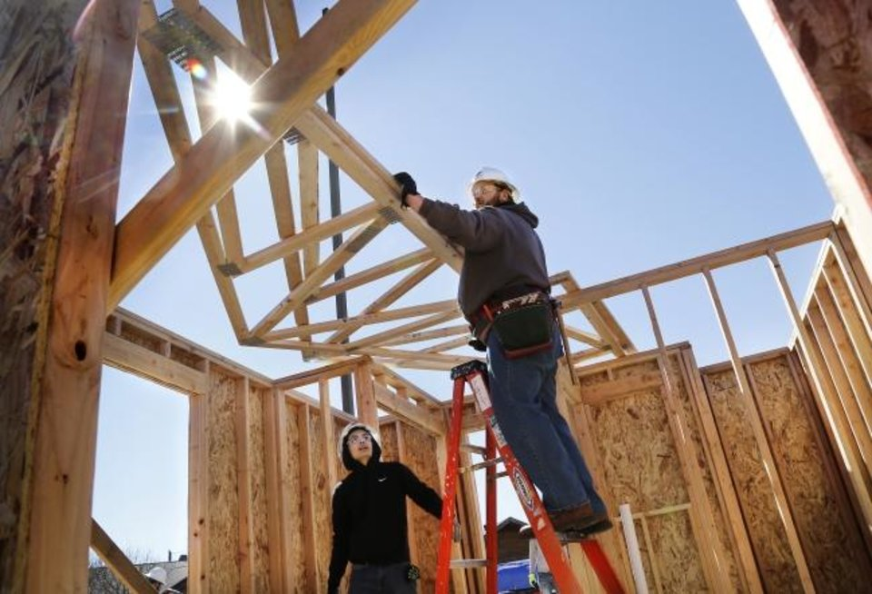 Photo - Students from Oklahoma State University-Oklahoma City construction technologies program are helping build tiny homes at Pivot: A Turning Point for Youth. When the homes are finished, they will accommodate teens who are aging out of the foster care system. The students are working under the direction of Terry Clinefelter, department head for construction technologies at OSU-OKC.  Photo taken on Friday, March 16, 2019.  Photo by Jim Beckel, The Oklahoman.