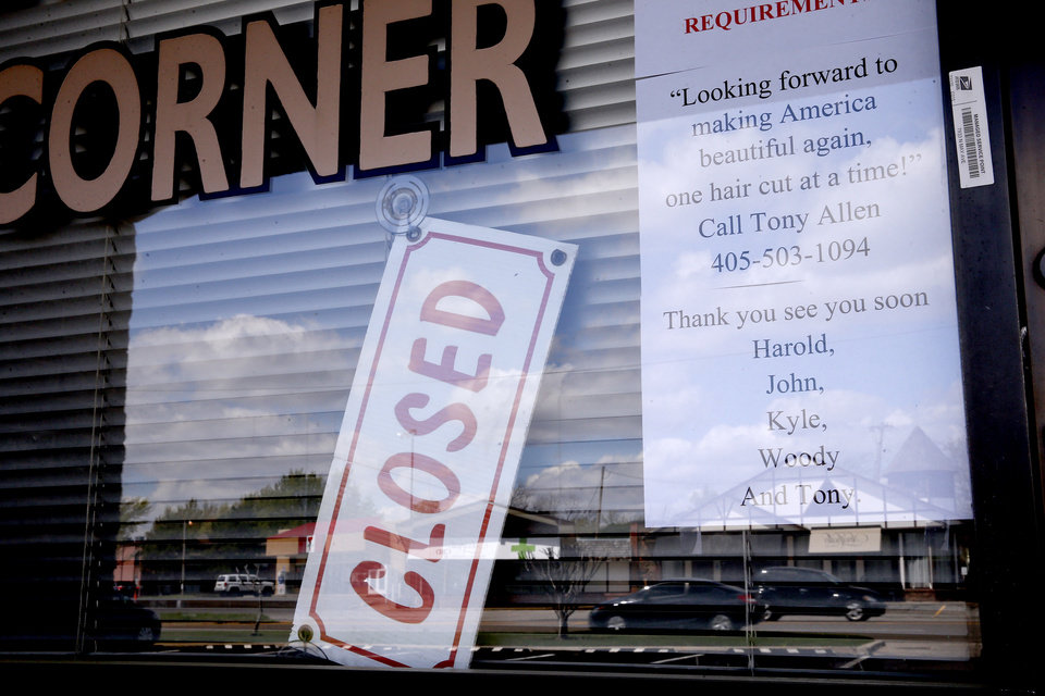 Photo - A closed sign on the window of the Barber Shop Corner on May Avenue in Oklahoma City, Tuesday, March 31, 2020. [Bryan Terry/The Oklahoman]