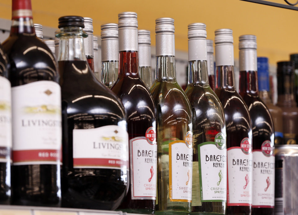 Photo -  A selection of wine is seen Wednesday at Bryan Kerr's Moore Liquor in Moore. [Photo by Steve Sisney, The Oklahoman]
