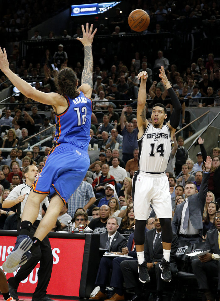 Photo - San Antonio's Danny Green (14) makes a 3-pointer as Oklahoma City's Steven Adams (12) defends during Game 5 of the second-round series between the Oklahoma City Thunder and the San Antonio Spurs in the NBA playoffs at the AT&T Center in San Antonio, Tuesday, May 10, 2016. Oklahoma City won 95-91. Photo by Bryan Terry, The Oklahoman