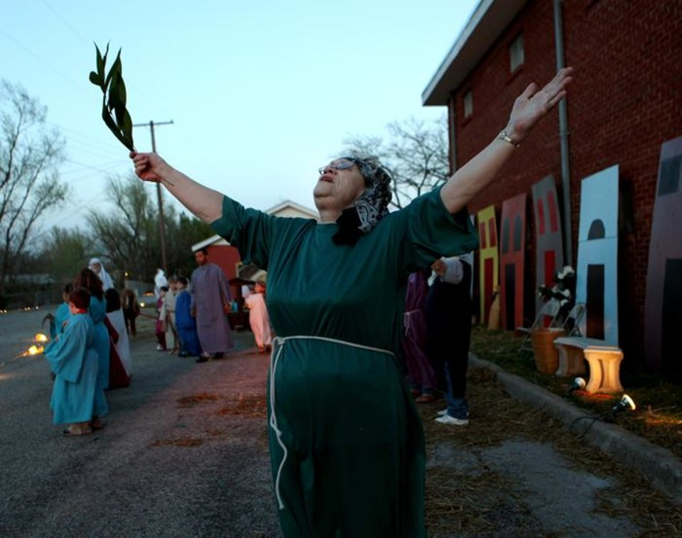 Photo -  EASTER DRIVE-THROUGH PAGEANT: Wanda Dewitt sings a hymn and waves a palm branch as she participates in the Easter Drive-Thru Pageant outside Del City First Church of the Nazarene in Del City, Okla., on Wednesday, March 31, 2010. The program will run through Friday from 7-9 p.m. Photo by John Clanton, The Oklahoman ORG XMIT: KOD