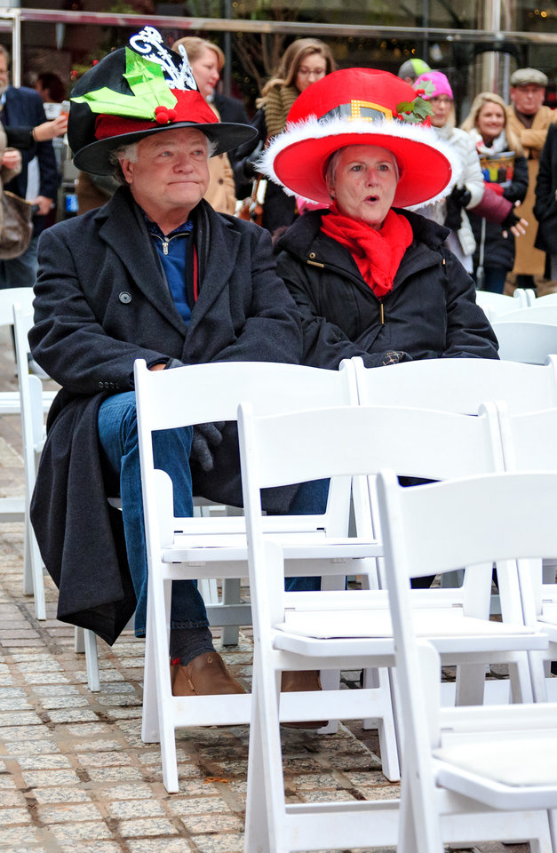 Photo - Kenny and Cynde Holloway gather outside of Leadership Square to celebrate the grand opening ceremony of the Oklahoma City streetcar system in downtown Oklahoma City, Okla. on Friday, Dec. 14, 2018. Photo by Chris Landsberger, The Oklahoman