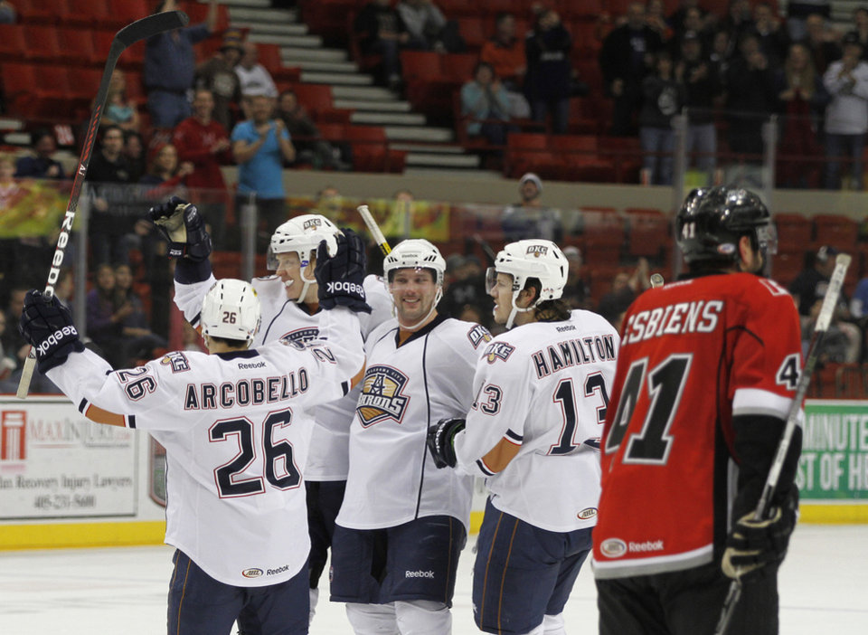 Photo - The Barons celebrate after a goal during a game between the Oklahoma City Barons and the Abbotsford Heat in Oklahoma City, Sunday, Jan. 15, 2012.  Photo by Garett Fisbeck, For The Oklahoman