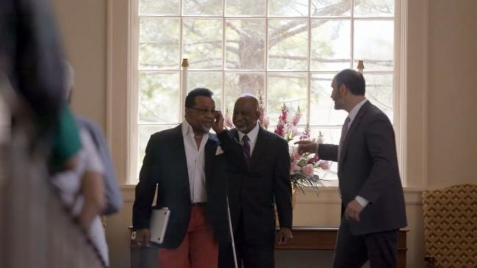 Photo -  All Souls Unitarian Church ministers Bishop Carlton Pearson, Gerald Davis and Marlin Lavanhar are shown in a scene from the documentary