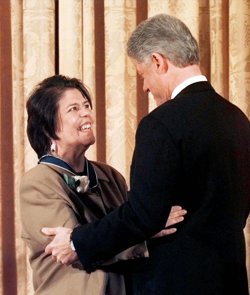 Photo - In this Jan. 15, 1998, photo, President Bill Clinton hugs Wilma Mankiller after presenting her with the Presidential Medal of Freedom at the White House. AP ARCHIVE