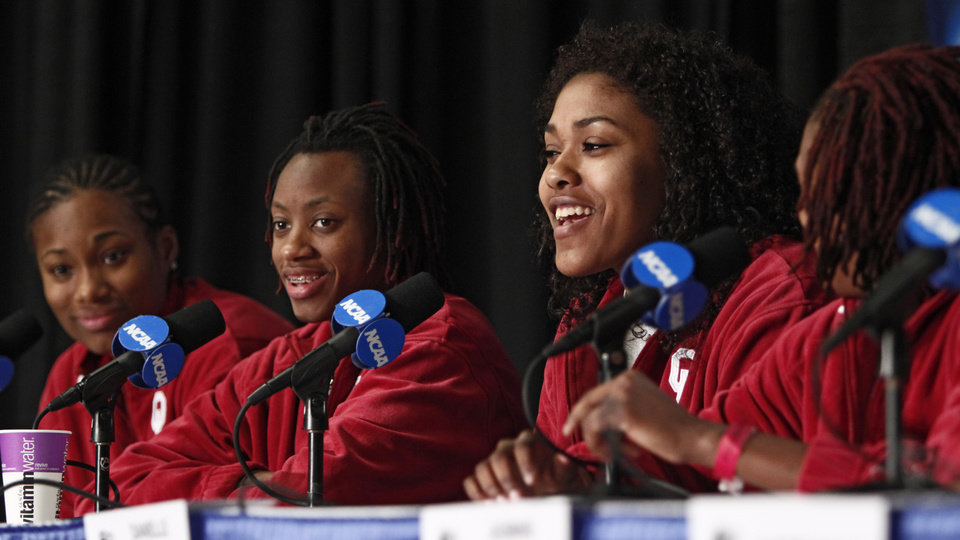 Photo - OU's Amanda Thompson, left, Nyeshia Stevenson, Abi Olajuwon, and Danielle Robinson speak during a press conference in Kansas City, Mo., on Monday, March 29, 2010. Oklahoma will play Kentucky in the regional championship game of the NCAA women's tournament on Tuesday, March 29, 2010.