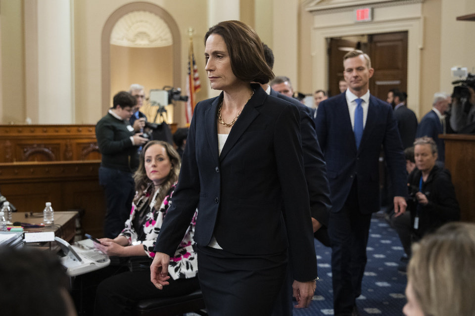 Photo -  Former White House national security aide Fiona Hill, and David Holmes, a U.S. diplomat in Ukraine, back right, walk to their seats to testify before the House Intelligence Committee on Capitol Hill in Washington on Thursday, during a public impeachment hearing of President Donald Trump's efforts to tie U.S. aid for Ukraine to investigations of his political opponents. [AP Photo/Manuel Balce Ceneta]