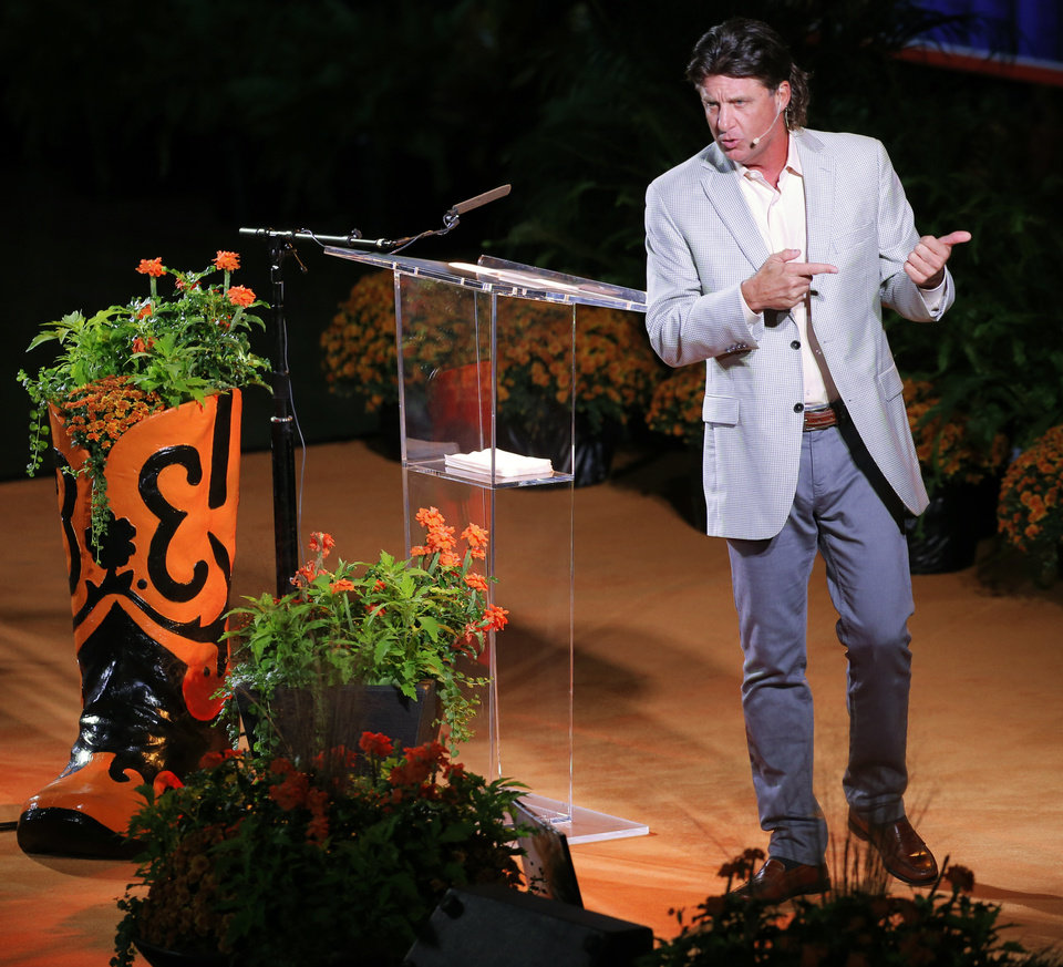 Photo - Oklahoma State football coach Mike Gundy speaks during the Celebration of Life for OSU alumnus and benefactor Boone Pickens at Gallagher-Iba Arena in Stillwater, Okla., Wednesday, Sept. 25, 2019. [Nate Billings/The Oklahoman]