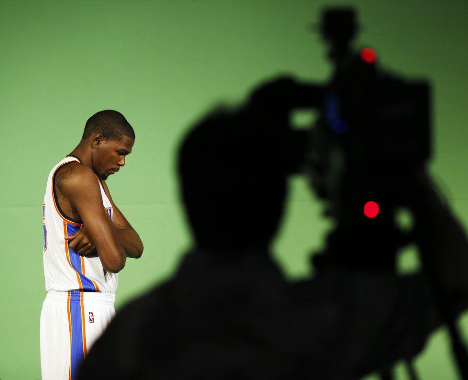 Photo - Kevin Durant poses on a green screen for use on the arena video scoreboard during media day for the Oklahoma City Thunder NBA basketball team at the Thunder Events Center in Oklahoma City, Monday, Oct. 1, 2012.  Photo by Nate Billings, The Oklahoman