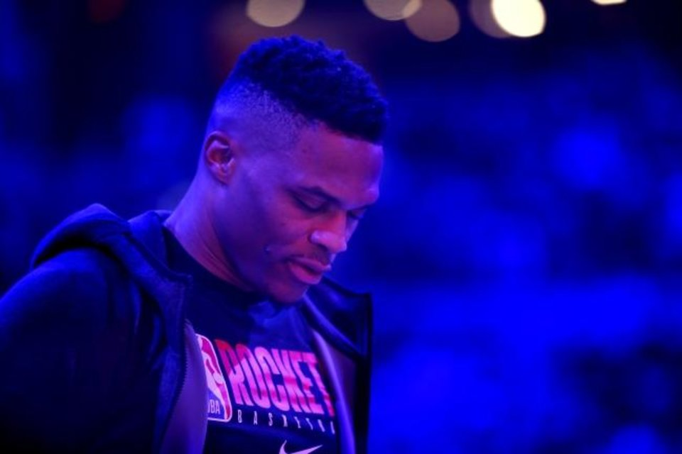 Photo -  Houston's Russell Westbrook (0) stands before Thursday night's game between the Oklahoma City Thunder and the Houston Rockets at the Chesapeake Energy Arena. [Sarah Phipps/The Oklahoman]