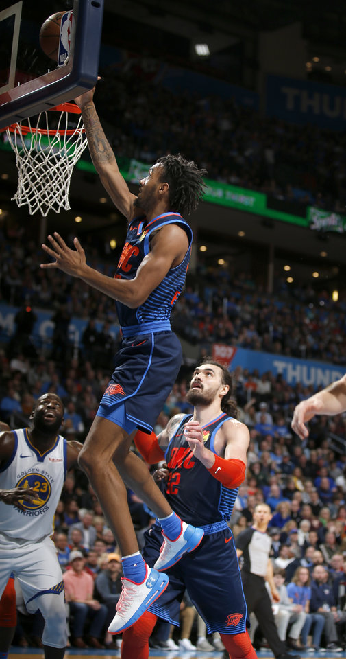 Photo - Oklahoma City's Terrance Ferguson (23) shoots a lay up during the NBA basketball game between the Oklahoma City Thunder and the Golden State Warriors at Chesapeake Energy Arena,  Saturday, March 16, 2019. Photo by Sarah Phipps, The Oklahoman
