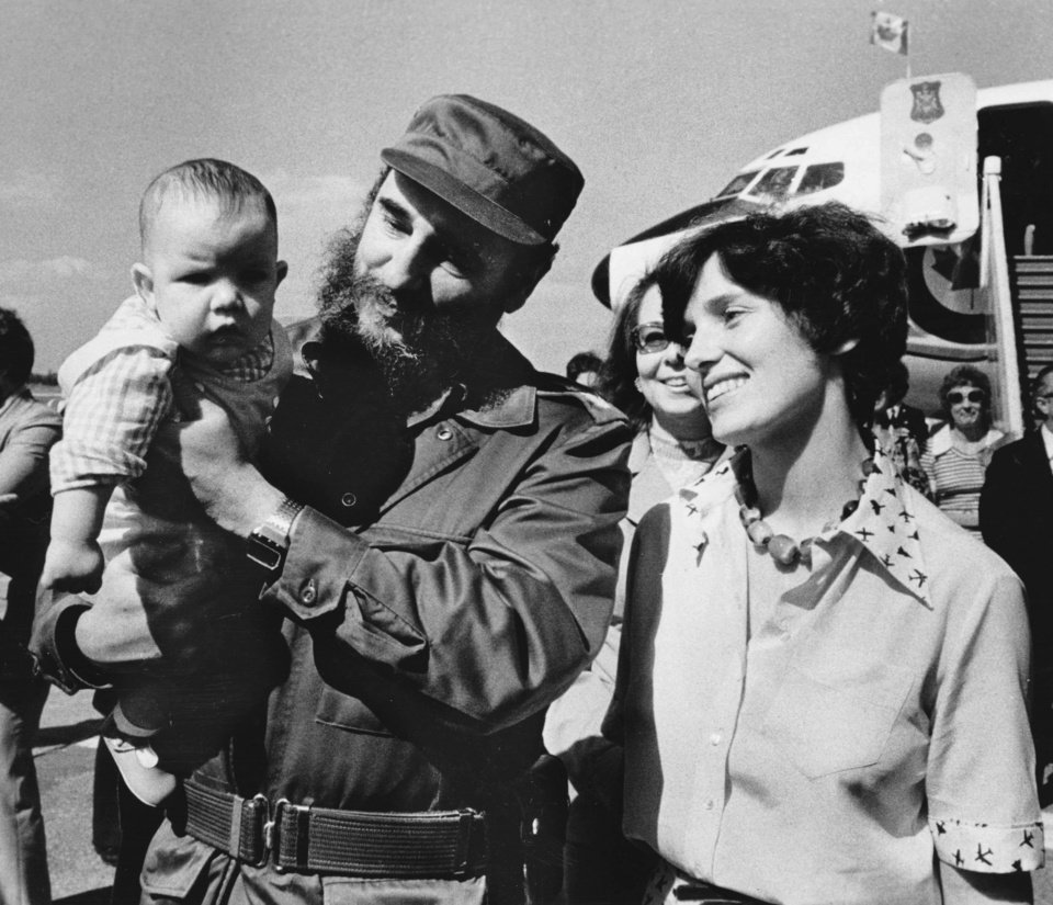 Photo - In this Jan. 26, 1976 photo, Margaret Trudeau smiles as Cuban President Fidel Castro holds her youngest son Michel after the Trudeaus arrived in Havana, Cuba. Castro, who led a rebel army to improbable victory, embraced Soviet-style communism and defied the power of 10 U.S. presidents during his half century rule of Cuba, died at age 90 late Friday, Nov. 25. (Fred Chartrand/The Canadian Press via AP)