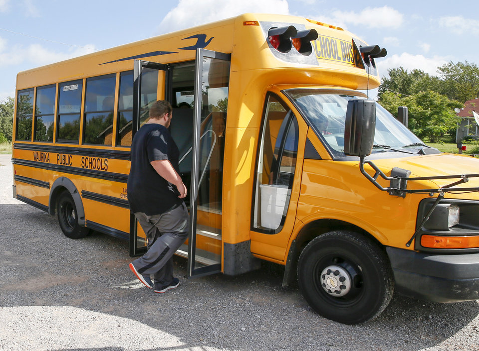 Photo - Jared Bartley, 17, of Waurika, boards a school bus to attend a vocational school for the afternoon at FAME Academy, an alternative school in Comanche Public Schools, in Meridian, Okla., Wednesday, Oct. 3, 2018. Photo by Nate Billings, The Oklahoman