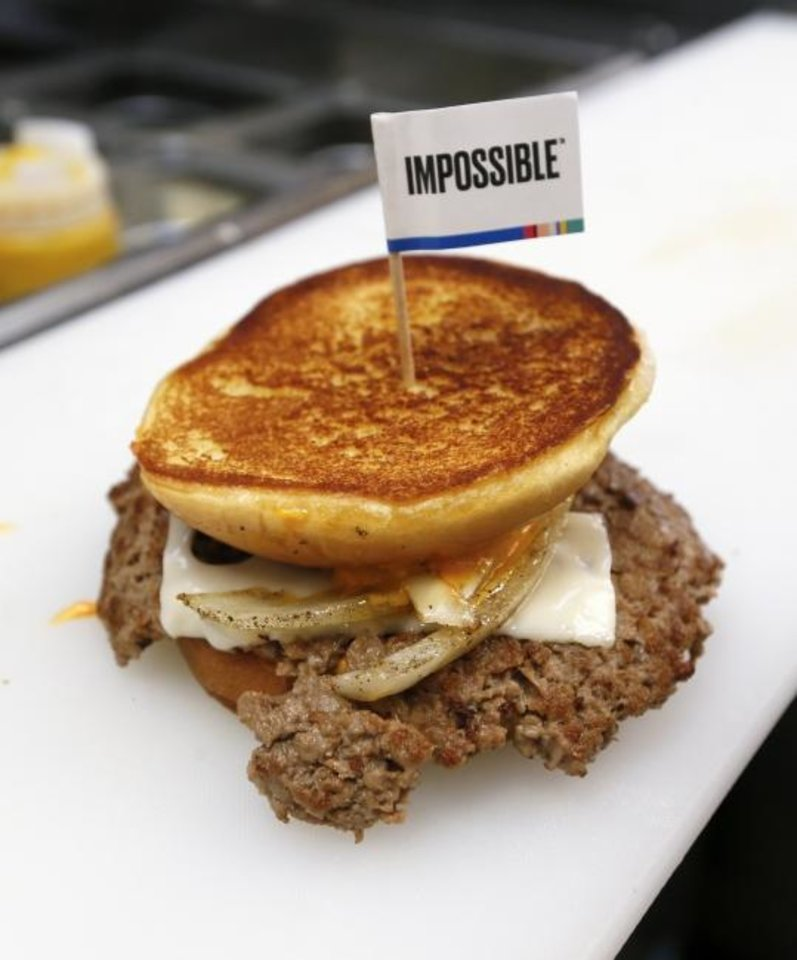 Photo -  The plant-based Impossible Melt is shown at Wayback Burgers in Edmond. As many Christians modify their diets during Lent, restaurants are expanding their meatless food offerings.  [Nate Billings/The Oklahoman]