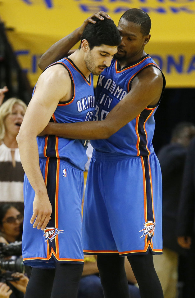 Photo - Oklahoma City's Kevin Durant (35) talks to Enes Kanter (11) after Kanter committed a foul during Game 5 of the Western Conference finals in the NBA playoffs between the Oklahoma City Thunder and the Golden State Warriors at Oracle Arena in Oakland, Calif., Thursday, May 26, 2016. Photo by Nate Billings, The Oklahoman