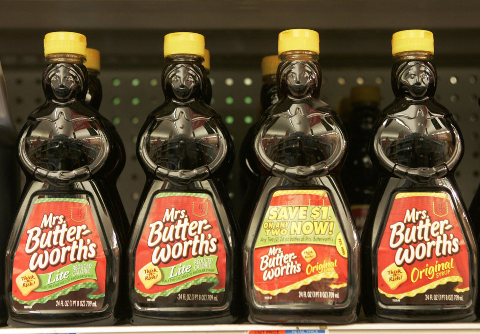 "Photo -  FILE - In this Nov. 20, 2007 file photo, bottles of Mrs. Butterworth's syrup are displayed on a supermarket shelf in Basking Ridge, N.J. Mrs. Butterworth  and Cream of Wheat are the latest brands reckoning with racially charged logos. Chicago-based Conagra Brands, which makes Mrs. Butterworth's syrup, said its female-shaped bottles are intended to evoke a ""loving grandmother."" But the company said it can understand that the packaging could be misinterpreted.  The soul-searching comes in the wake of PepsiCo's announcement Wednesday, June 17, 2020, that it's renaming its Aunt Jemima syrup brand. (AP Photo/Mike Derer, File)"
