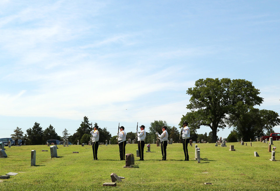Photo - Stephens County Honor Guard conduct a 21 guns salute at the memorial for U.G. Moore, a WWI vet whose grave marker never make it to his grave at Trice Hill Cemetery, until 55 years after his death, Tuesday, July 16, 2019. [Doug Hoke/The Oklahoman]
