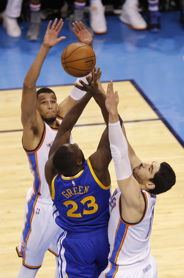 Photo - Oklahoma City's Andre Roberson (21) and Enes Kanter (11) defend Golden State's Draymond Green (23) during Game 6 of the Western Conference finals in the NBA playoffs between the Oklahoma City Thunder and the Golden State Warriors at Chesapeake Energy Arena in Oklahoma City, Saturday, May 28, 2016. Photo by Bryan Terry, The Oklahoman