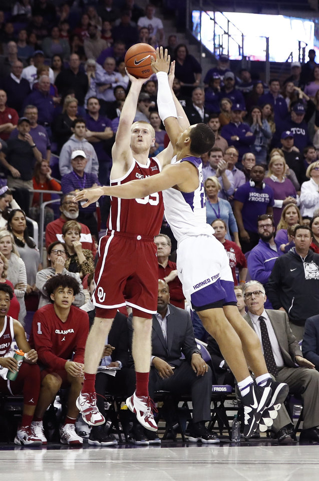 Photo - Mar 7, 2020; Fort Worth, Texas, USA; Oklahoma Sooners forward Brady Manek (35) shoots over TCU Horned Frogs forward Jaedon LeDee (23) during the second half at Ed and Rae Schollmaier Arena. Mandatory Credit: Kevin Jairaj-USA TODAY Sports