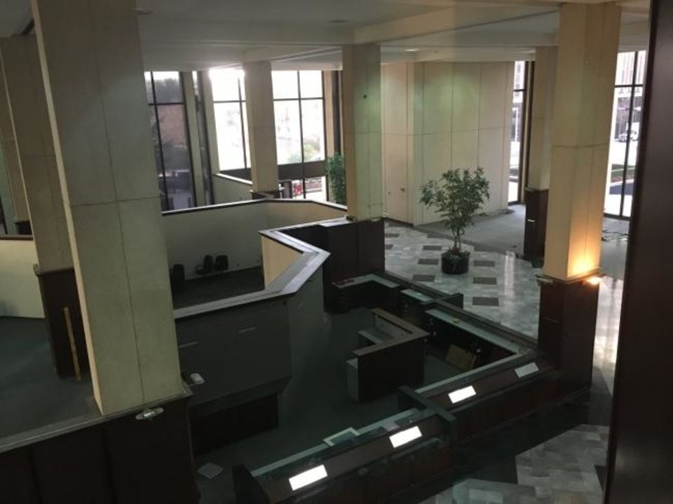 Photo -  The two-story lobby at 201 Robert S. Kerr, formerly home to Bank of Oklahoma's Oklahoma City operation, reflects the darker decor that was popular in the 1970s and 1980s. [PROVIDED]