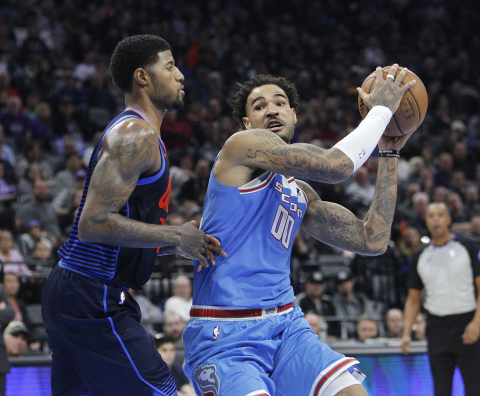 ... Photo - Sacramento Kings center Willie Cauley-Stein (00) drives to the  basket